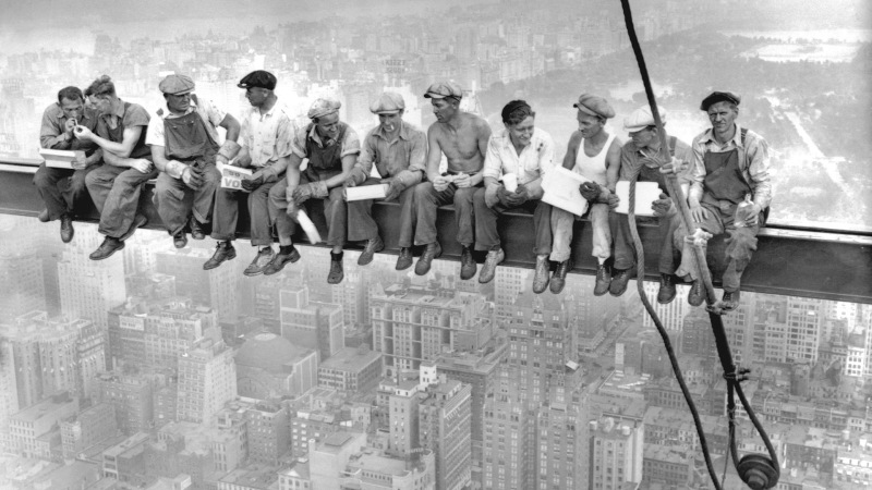 29 Sep 1932, Manhattan, New York City, New York State, USA --- Construction workers eat their lunches atop a steel beam 800 feet above ground, at the building site of the RCA Building in Rockefeller Center. --- Image by © Bettmann/CORBIS